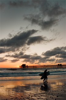 Oceanside pier and surfers at sunset